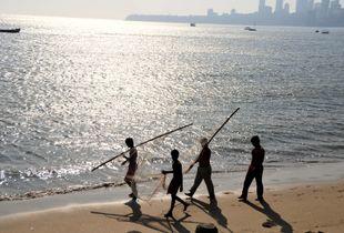 Playing on the beach - Mumbai Chowpatty bay, INDIA