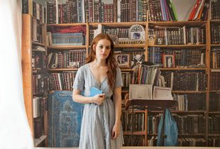 Lea in my studio with a wallpaper of her father books, Berlin, 2019