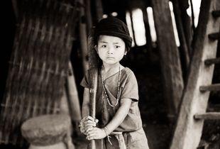 Wa Hill-tribe Girl Pounding Rice - Shan State, Myanmar