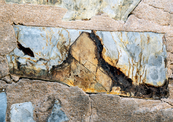 Rock painting. Old house