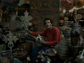 Solomon, an antique dealer with an artifact of almost every location one can journey to in Ethiopia