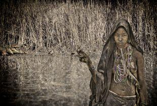 An Ari Tribe girl in Omo valley, Ethiopia