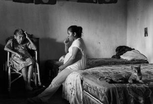 Together but apart these two women visit, quietly thinking about the past and the future.                       © Lola Reid Allin