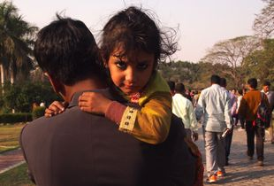 Father & Daughter joining the crowd at the Lotus Temple, Dehli. 2018.