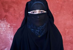 "Jdeideh, Lebanon. Rabiah, 15 years old, comes from the village of Zahra. She arrived in Lebanon almost three months ago, together with her family. A 9th grade student, she already lost one year at school because of the uprising. She constantly has nightmares, where she dreams of bullets chasing her while she tries to run away. ""I wake up crying and screaming,"" she says. © Matilde Gattoni"