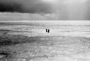 Two kids in the ocean