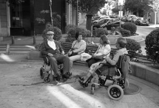 People sitting on a bench in Madrid