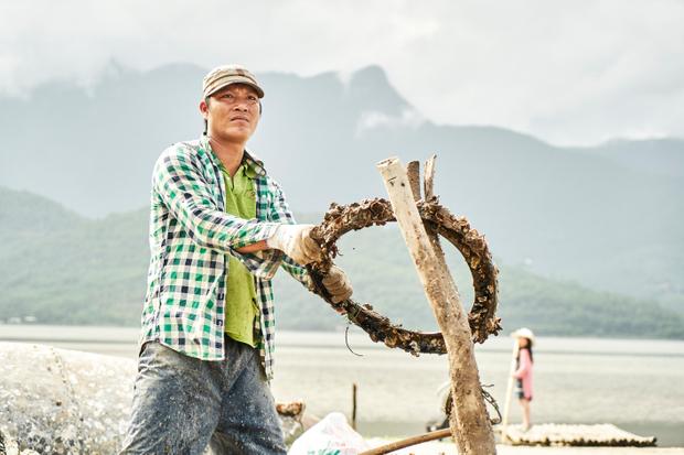Vietnamese Oyster Fisherman