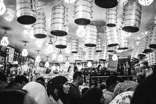 Food carrying boxes hanging from the ceiling at a shop