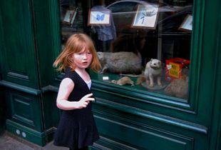 Girl Outside Musée des Rats