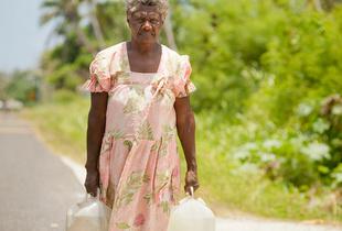Edna Kalskar, 61 years, collecting water for her home, Eton Village, Efate Island.