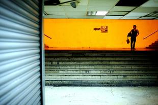 Shoe Polisher Under a PassageWay