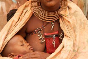 A Himba woman breastfeeding