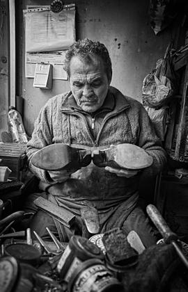 Cobbler deep in his work Istanbul.