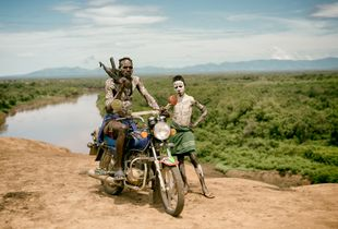 Oyta, his boy, and the village motorbike. Kara tribe, Southern Ethiopia.