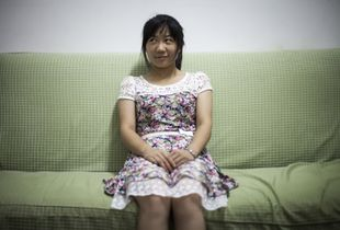 Wang Hui sitting in the living-room