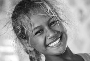 Teaneikura can't hide her happy smile on her last school day of the year in Omoka on the atoll Penrhyn