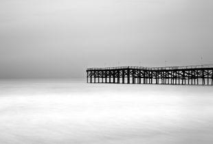 Crystal pier on a gray morning.