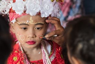 Applying makeup before starting the whole ceremony.