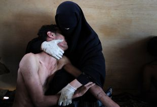 World Press Photo of the Year 2011: © Samuel Aranda, Spain, for The New York Times. Sanaa, Yemen, 15 October. A woman holds a wounded relative during protests against president Saleh.