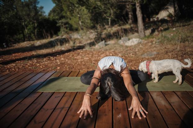 Laura practices yoga
