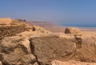 Tourists admire the view from the top of the Masada fortress. Masada, Israel