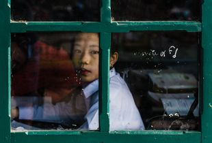 Through the window : a Laotian schoolgirl.