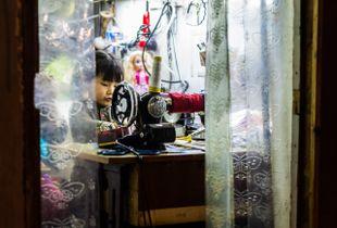 Das Kind an der Nähmaschine