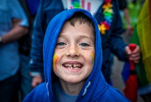 Young boy on the street in Dublin during Pride Parade.