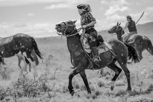 Gauchos on horseback