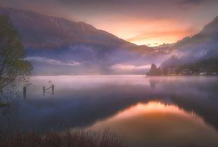 Foggy sunrise in the lake
