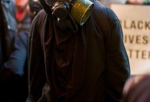 Demonstrators in a mask