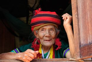 Elderly woman with traditional facial tattoos. Mindat, Myanmar.