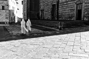 Nuns cross the Piazza Grande