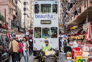 Tram, shoppers and the refuse collector compete for space.