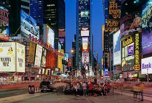 """<a href=""""https://andrewprokos.com/photos/new-york/times-square/"""">Times Square Dusk Panorama</a>"""