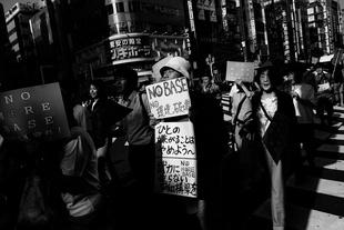 People take part of a demonstration against the US base in Henoko (Okinawa) in Shinjuku