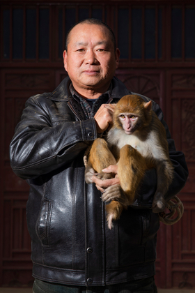 The portrait of the monkey charmer
