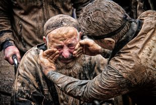sparge of mud over their bodies on Ashura day.