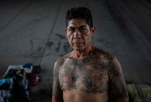 Tijuana, Mexico, November 17th, 2014. Jesus Zuniga, 51, lived in Anaheim, CA, for 32 years and had his own business, a German wife and two children, Jana, 17, and Isaias, 18. He did 20 years in prison for transporting drugs and was deported in 2010 for illegal reentry. He now lives at El Bordo, where he collects clothes, washes them in the river and resells them. He also makes rings and bracelets.