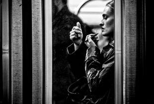 Woman Applying Makeup Inside A Subway Train, Manhattan, NYC