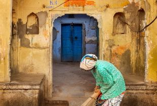 Old woman cleaning the Temple