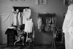 Cuba. Girl in a shop.