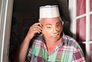 Stuart in his doorway wearing a mask