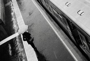 Umbrella. Train. Rain.