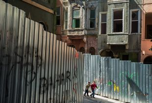 Boys playing in the hulks of Tarlabashe in Istanbul
