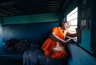 Indian Woman Slumping in the Railway Train