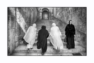 Pilgrims women, going up the stairs in Via Delarosa,The Holy City.