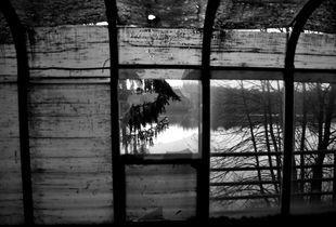 View of a Lake from a broken window