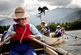 Bai ethnic minority woman fishing with cormorant